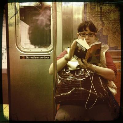 Reader on train - by Bonnie Natko